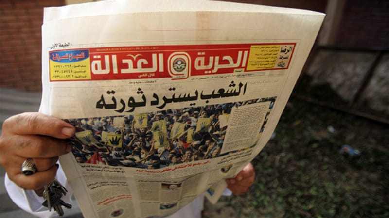 Police stormed the newspaper's Cairo building overnight and removed the contents [Reuters]