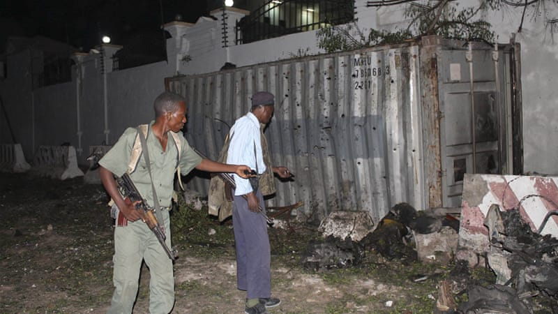 Three bombs exploded within an hour outside a hotel in a heavily fortified district of the Somali capital [Reuters]
