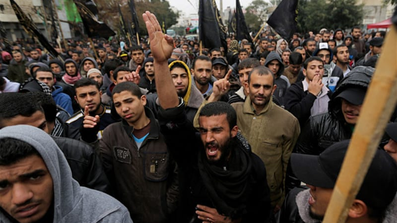 Palestinian supporters of the Islamic Jihad protested against peace talks in Gaza City on Friday [AP]