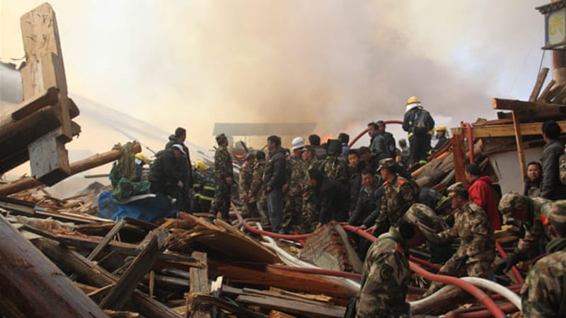 More than 2,000 people were battling the fire in the ancient Tibetan town of mostly wooden houses [EPA]