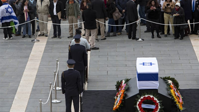 Thousands of Israelis paid their respects to the former leader in front of parliament on Sunday [AP]