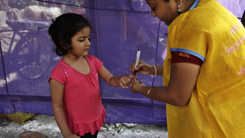 An Indian child gets her finger marked with ink after being vaccinated against polio [AP]