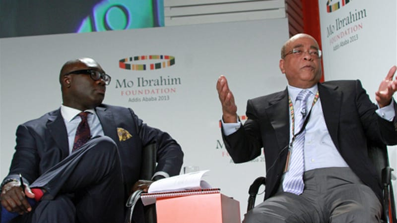 Dumor, left, with Mo Ibrahim, the chairman of the Mo Ibrahim Foundation, in Ethiopia last November [AP]