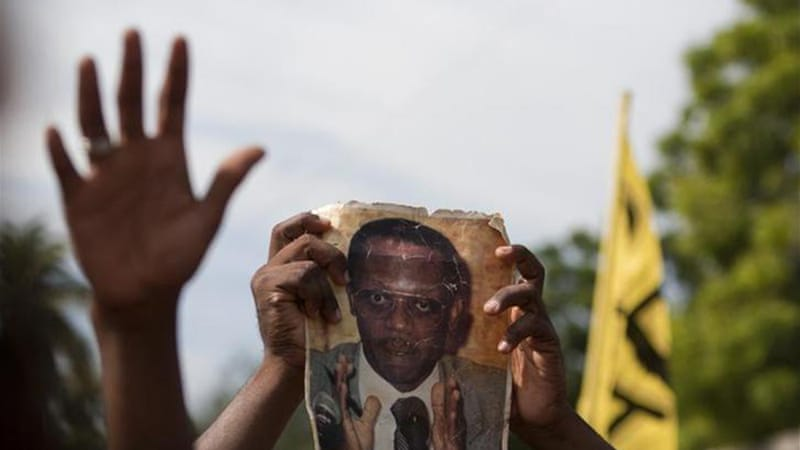 The judge in charge of the investigation did not indict Jean-Bertrand Aristide [AP]