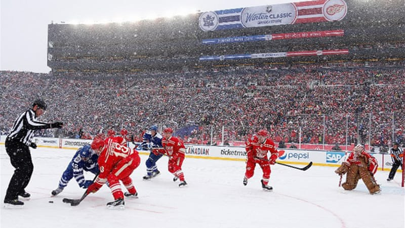 A record hockey crowd braved Arctic conditions to fill the Michigan Stadium in Ann Arbor [AFP]