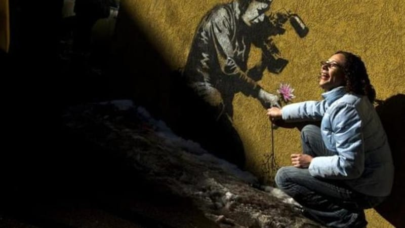 Vandals in Utah city targeted two works there by famous graffiti artist Banksy [AP]