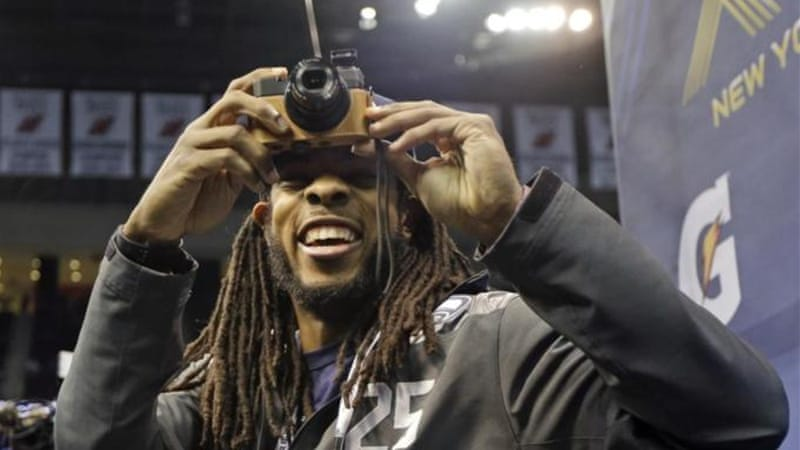Watching the snap: Seattle cornerback Richard Sherman will be in the spotlight in Sunday's game [AP]