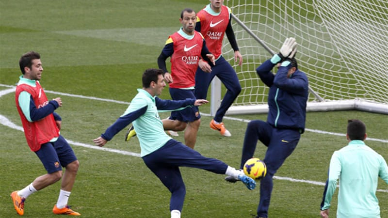 Lionel Messi shoots the ball at goalkeeper Jose Pinto during a training session at Mini stadium in Barcelona [Reuters]