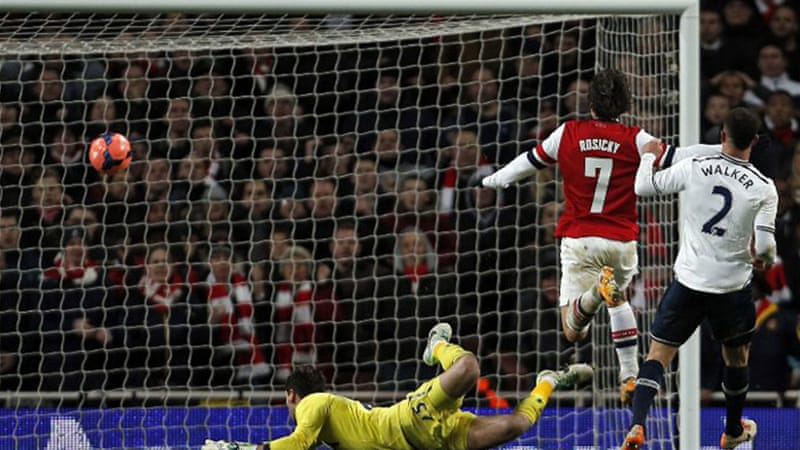 Arsenal midfielder Tomas Rosicky, second right, scores Arsenal's second goal against Tottenham  [AFP]