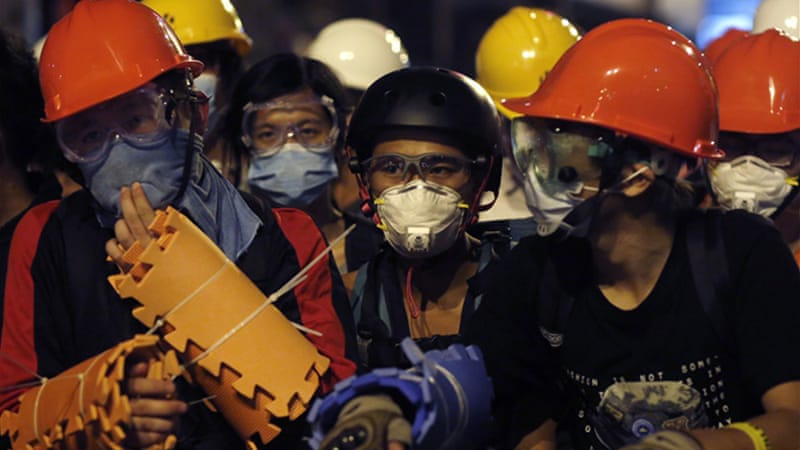 Protesters protected themselves with helmets, masks and foam pads [Reuters]