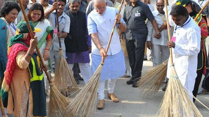 Modi swept the road in a poor neighbourhood in the capital, New Delhi [Photo courtesy: Press Information Bureau]