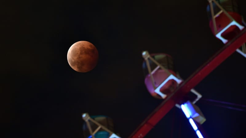 The red hue of the moon results from sunlight scattering off Earth's atmosphere [AFP]