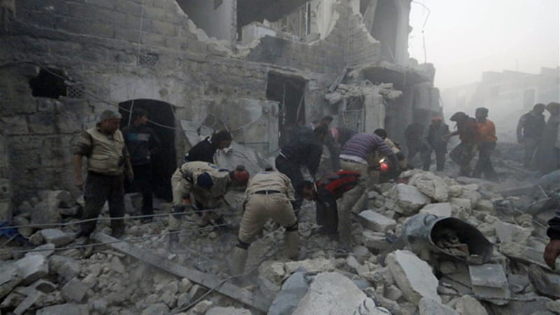 Images of a reported strike in Aleppo's al-Marjeh district showed men digging through rubble [Reuters]
