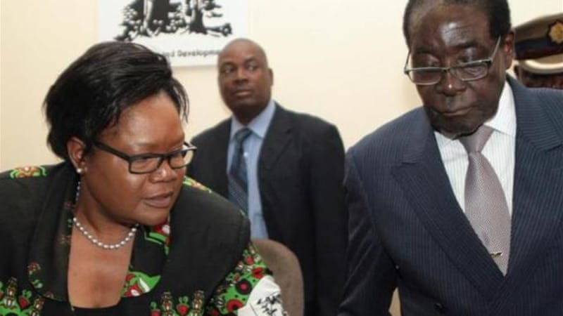 Mujuru, left, is seen as a leading contender to succeed Mugabe as the country's leader [AFP]
