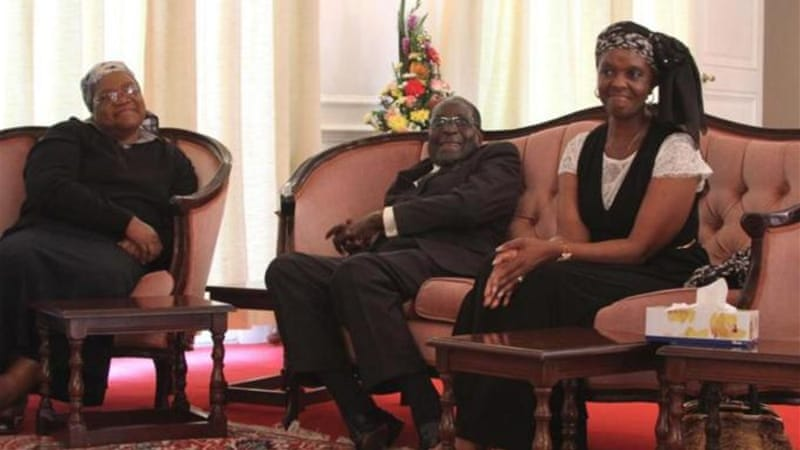 Mujuru, left, had a public fall out with Grace Mugabe, right, the wife of president Mugabe [AP]