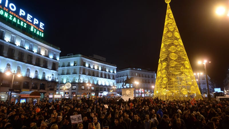 Thousands gathered in Madrid on Saturday under the the slogan 'Bread, work, shelter and dignity' [AFP]