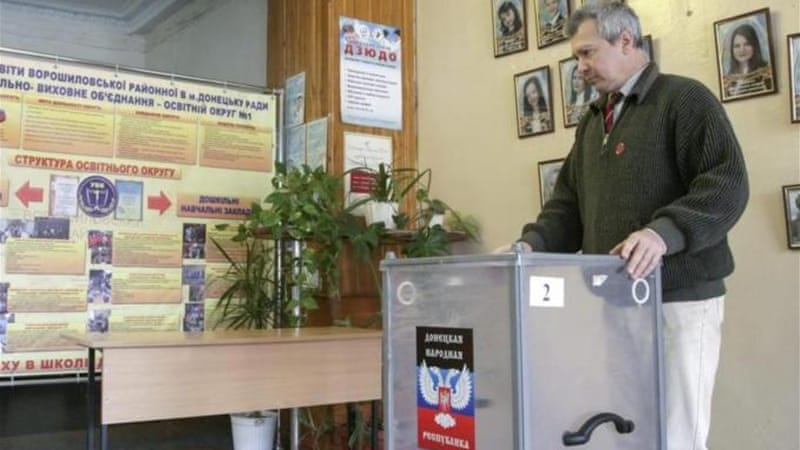 Ukraine witnessed two polls last month as both sides accuse each other of breaching accord [EPA]