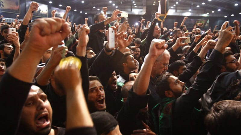 Thousands of Shia worshipers marched in the rain, weeping in memory of the slain imam, Hussein [Reuters]