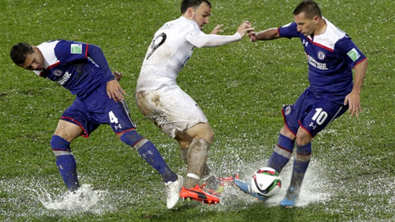 Heavy rain in Morocco left the pitch more like a rice paddy [EPA]