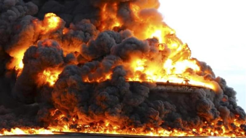 Seven of the 19 oil tanks at Al-Sidra were ablaze on Sunday as a result of the fighting [Reuters]
