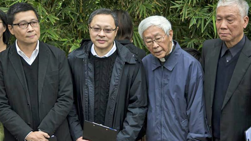 The three Occupy leaders were joined in their surrender by elderly Cardinal Joseph Zen [Reuters]