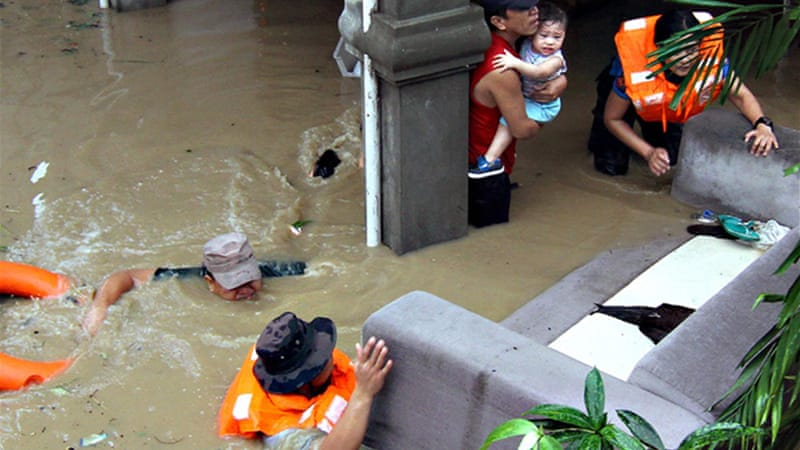 Floods destroyed bridges and highways, sending thousands of residents to evacuation centers [Reuters]