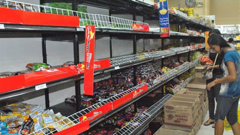 Supermarket shelves are cleared as residents of Tacloban stock up ahead of Hagupit's arrival [AFP]