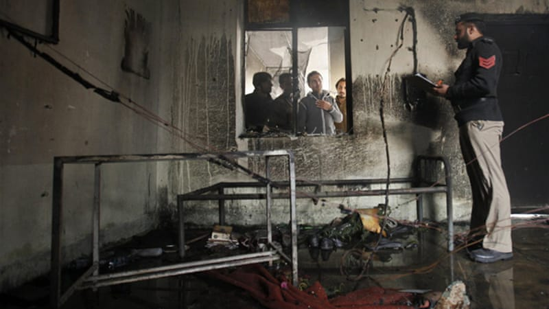 Rooms in a dormitory were burned during the clashes at the university [Reuters]