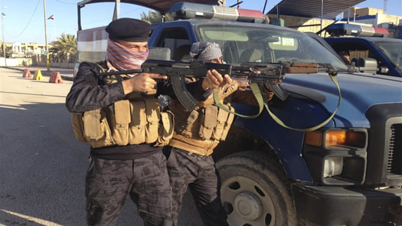 Iraqi troops fight to expel Sunni Islamist insurgents who took over parts of Anbar and northern Sulaiman Bek [Reuters]