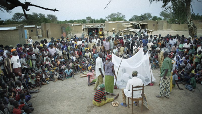 A theatre company explains the importance of using long-lasting insecticide-treated bed nets in the remote villages of Burkina Faso. Many villagers go to a traditional doctor to treat it. Most do not