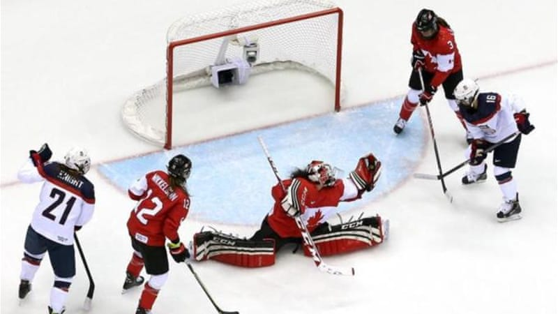 Canada' Shannon Szabados makes a glove save to help her team to gold over the United States [GALLO/GETTY]