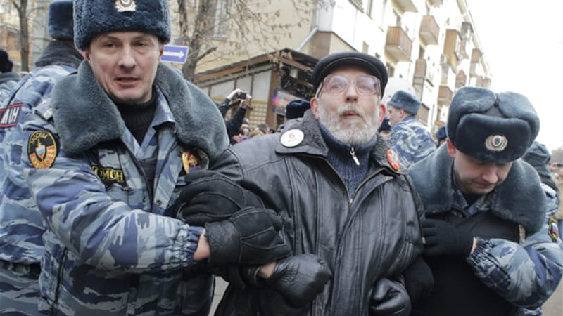 Police arrested about 200 people outside a Moscow courthouse where eight people were convicted [Reuters]
