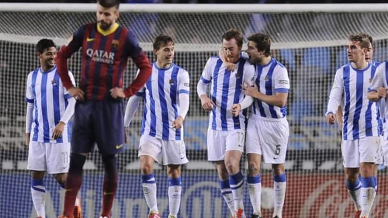Pique, who later said Barca had been uncomfortable on the ball, reacts to Sociedad's third [AP]