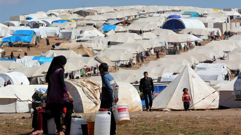 The town of Atmeh hosts a sprawling camp for thousands of displaced Syrians [EPA]