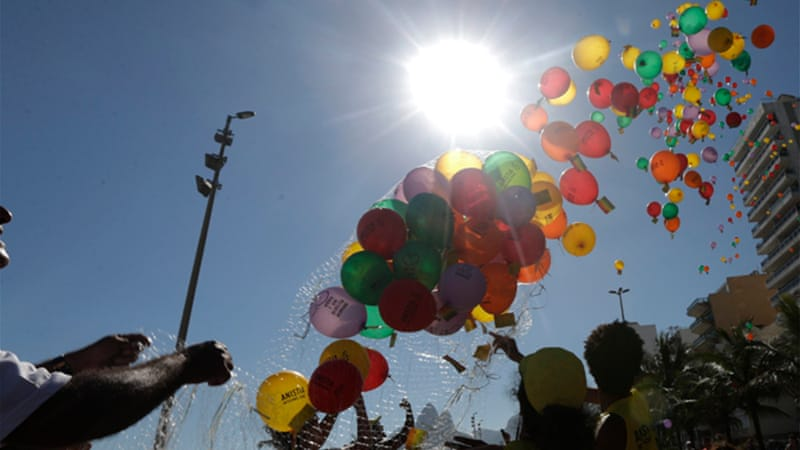 Demonstrators release balloons with messages against Russia's President Vladimir Putin and anti-gay laws [Reuters]