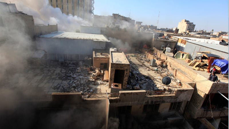 Smoke rises from the site of a bomb attack near Khullani Square in Baghdad [Reuters]