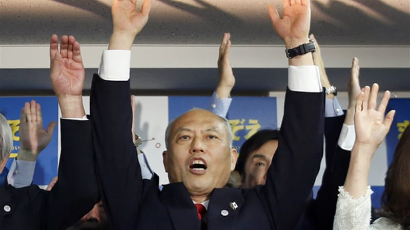 "Former Health Minister Yoichi Masuzoe joined his supporters, shouting ""Banzai"" or 10,000 years of life [Reuters]"
