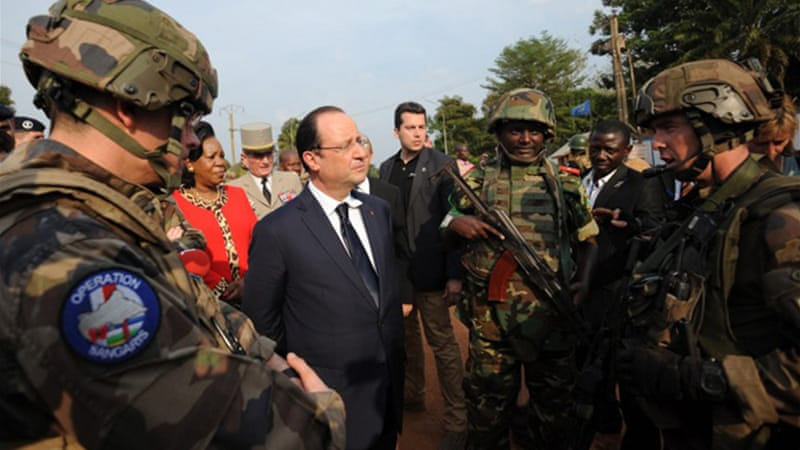 Arriving in Bangui, Hollande met the interim president and religious leaders, and addressed French troops [AFP]