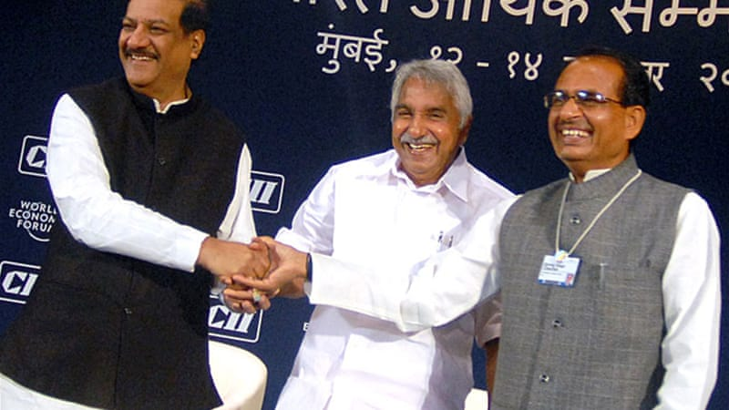 The complainant is linked to a scam over which Chief Minister Chandy's (centre) aide was arrested  [File: EPA]
