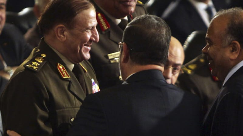 Anan served as chief of staff under Mubarak, and adviser to Morsi before resigning days before the coup [Reuters]