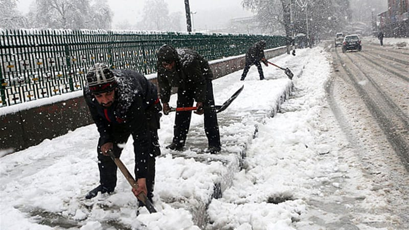 Srinagar, the summer capital of Indian-administered Kashmir, has seen unprecedented snowfall [EPA]