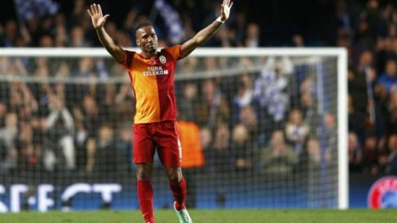 Drogba waves to the Chelsea fans after returning to the club where he won 10 major trophies [Reuters]
