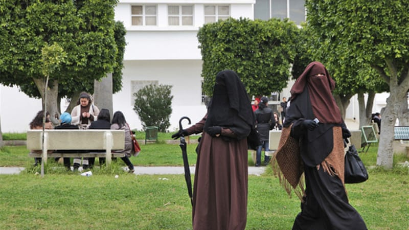 Some Tunisian women say restrictions on wearing the niqab would violate their religious rights [AP]