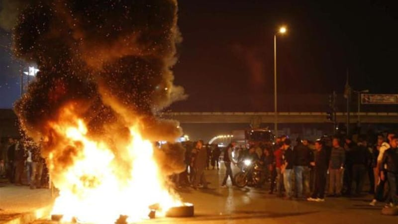 "Angry Sunnis blocked roads in Beirut on Tuesday night to protest what they called a ""siege"" of Arsal [Reuters]"