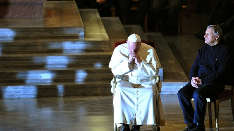 The pope prayed alongside Luigi Ciotti, who founded the anti-mafia group that organises the vigil [AFP]