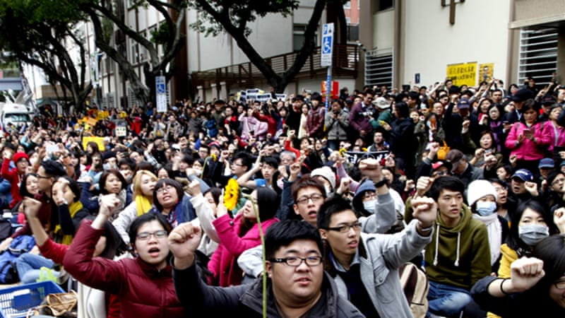 Hundreds of students broke into a parliamentary building on March 18 to protest against the trade pact [EPA]