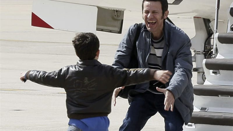 Javier Espinosa was welcomed by his son upon his arrival in Spain [EPA]