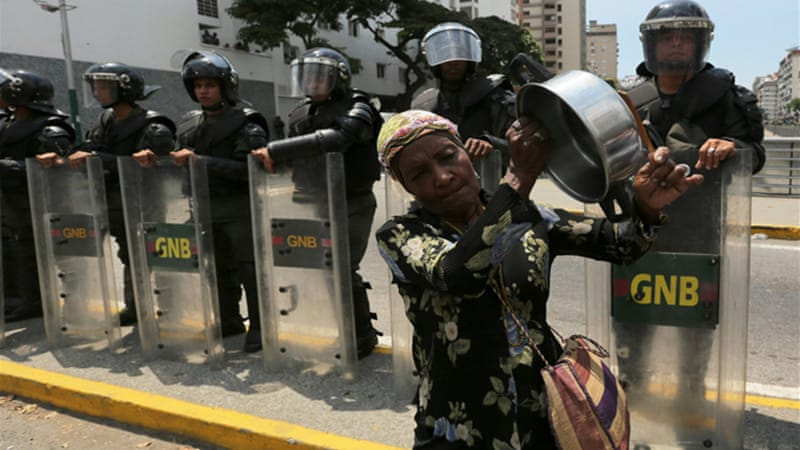 Caracas' government-allied mayor had refused the marchers a permit to hold the rally [AP]