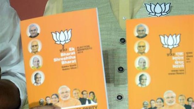 The BJP in its manifesto had said they would work towards abrogation of Article 370 [Raveendran/AFP]