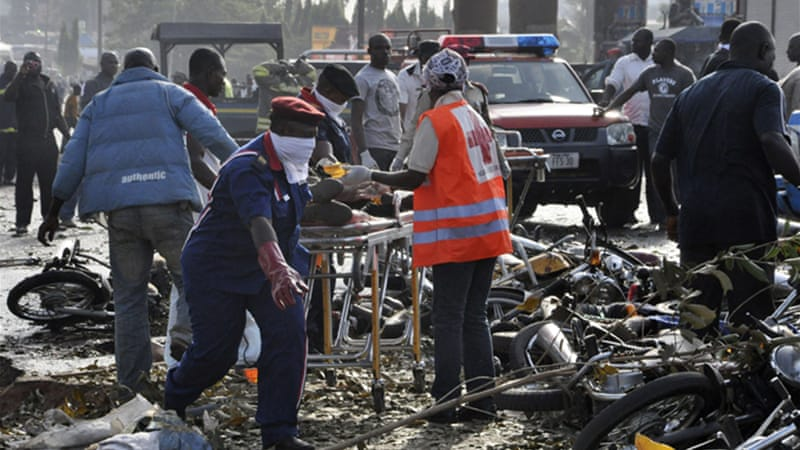 A bomb blast also killed at least 75 people near Abuja on the same day the schoolgirls were kidnapped [AP]